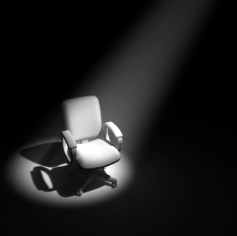 3d Office chair in spotlight